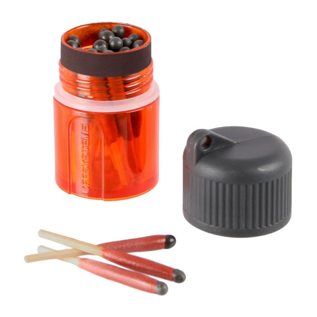 Orange pot of windproof matches with grey lid