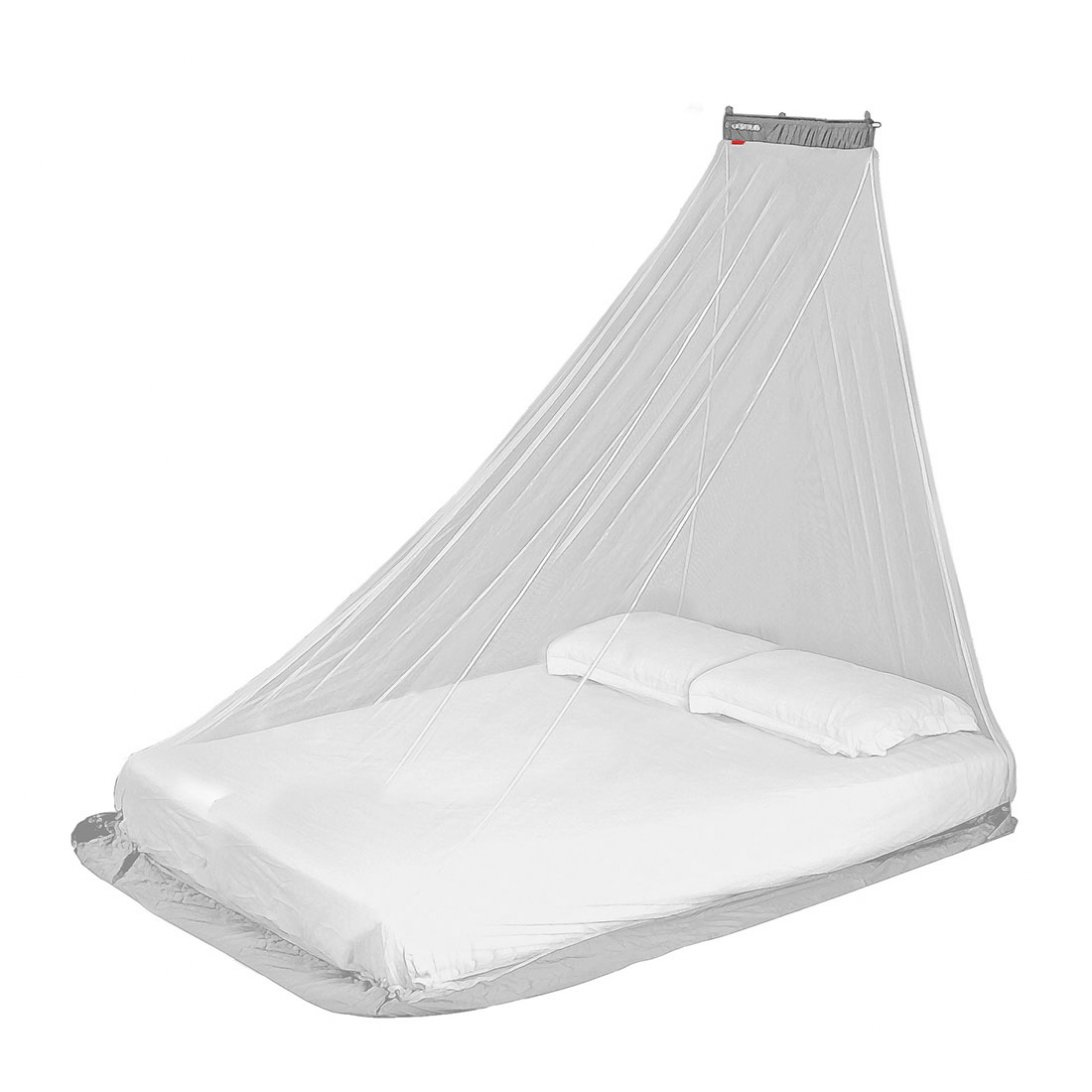 Compact mosquito net hanging over bed