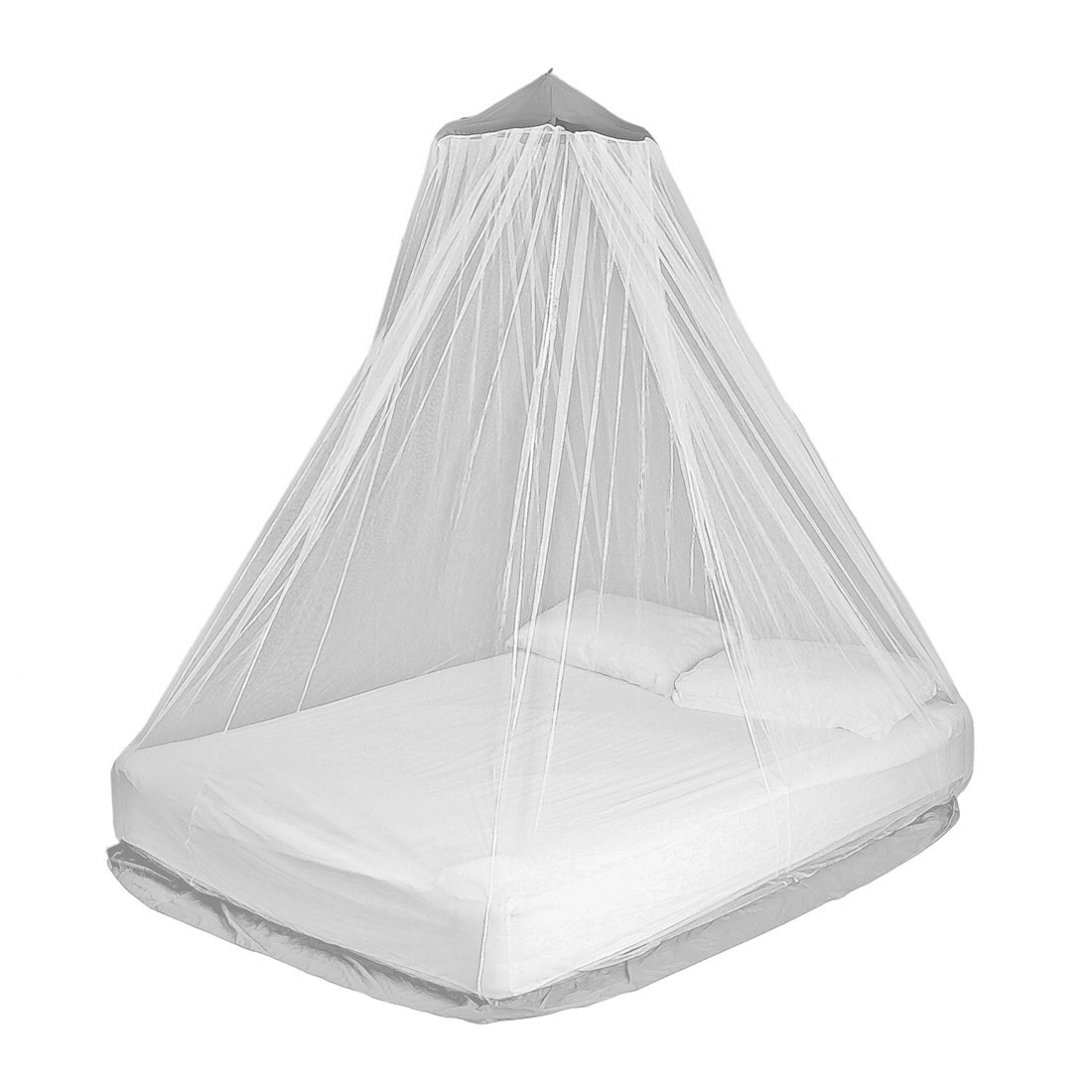 Double mosquito net hanging over bed