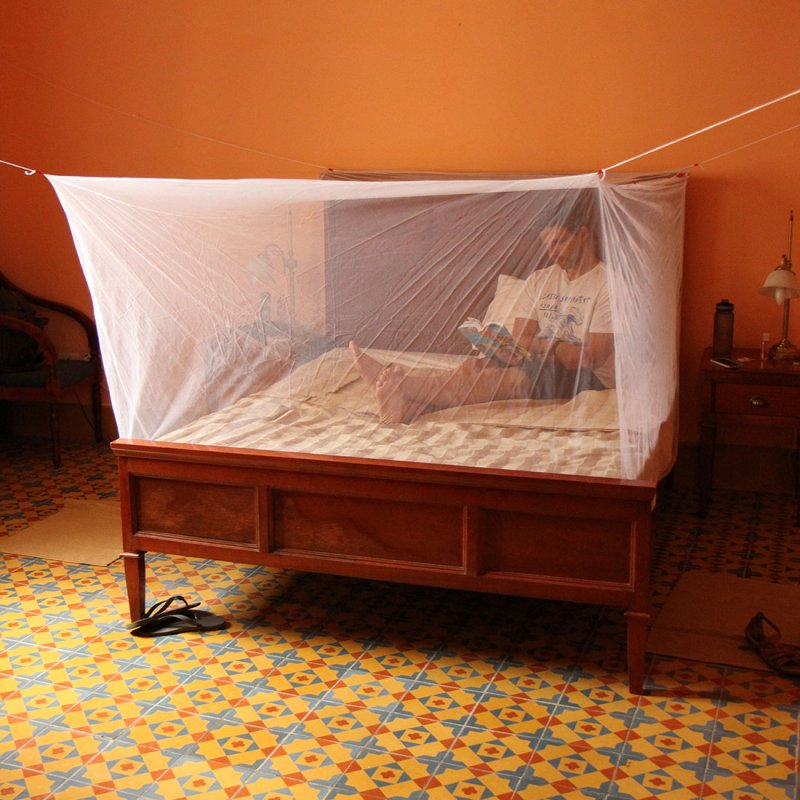 Lifestyle shot of double mosquito net in use